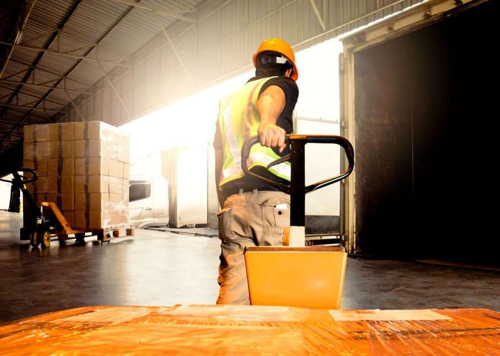 Warehouse Worker Unloading Product