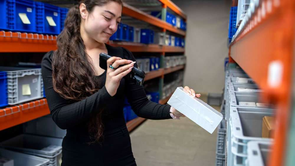 Sonim RS60 with Girl in Warehouse