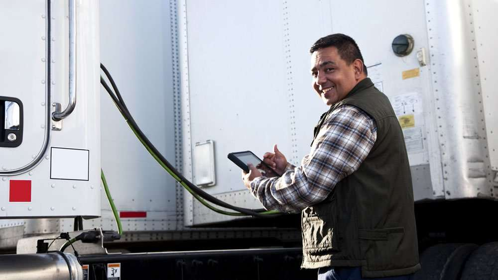 Truck driver using Dell Latitude 7220 Rugged Extreme Tablet