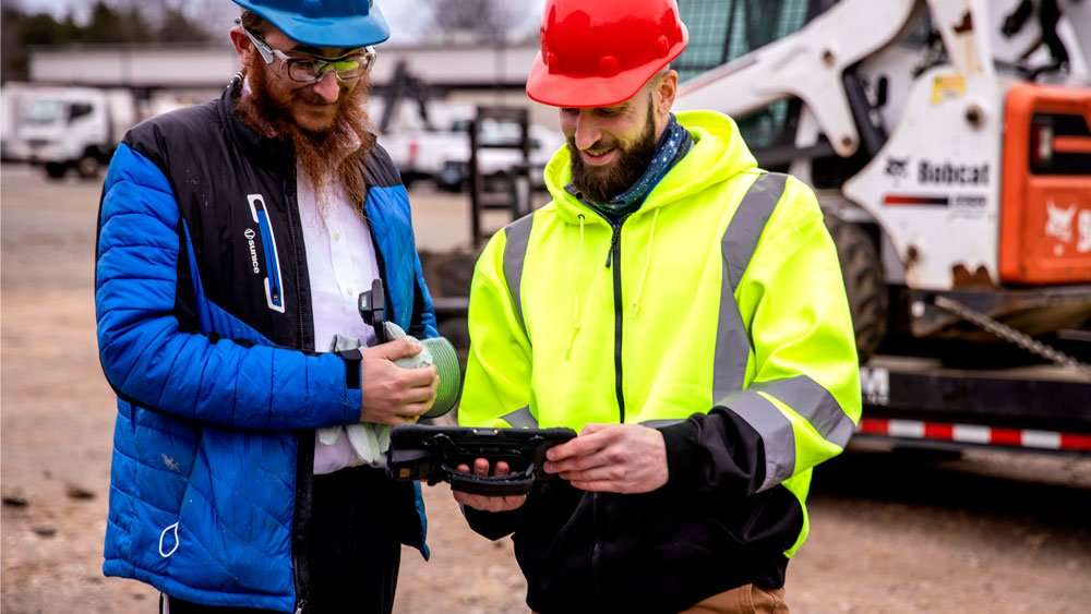 construction workers using rugged tablet