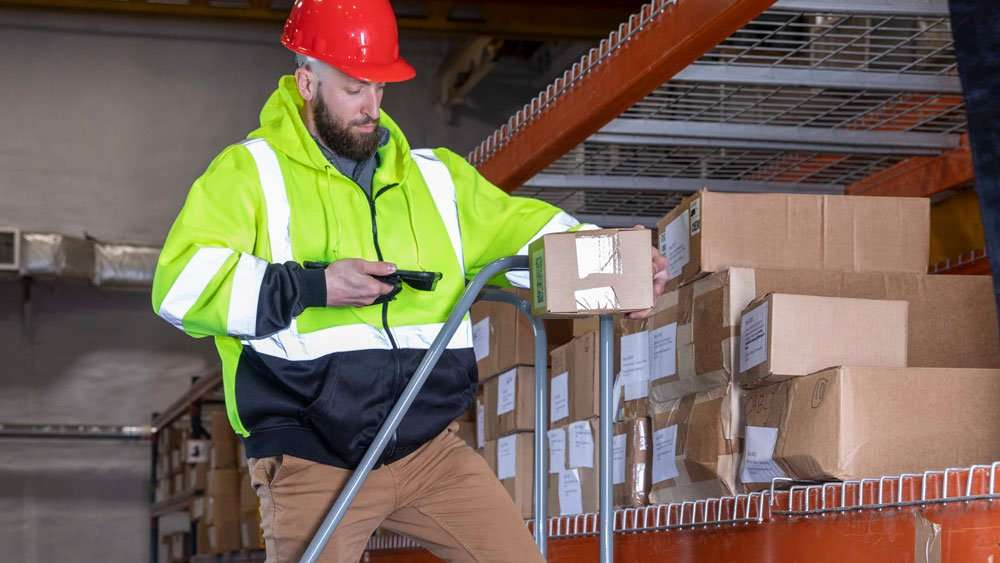 scanning box in warehouse with mobile device