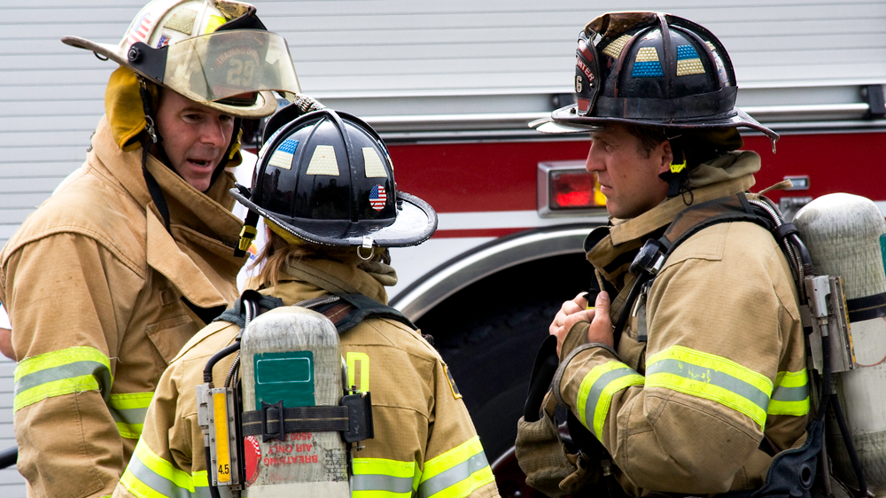 firefighters discussing