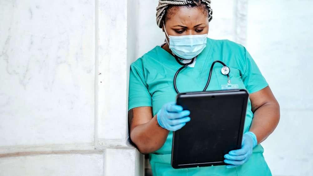 handheld tablet healthcare worker