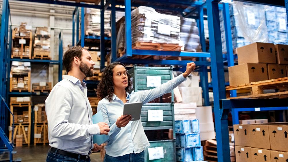 Man woman organizing warehouse