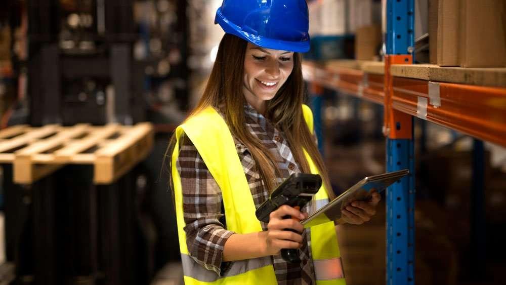 warehouse worker using mobile computer DataLogic Joya Touch