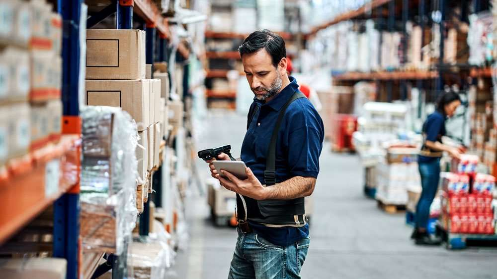 worker scanning in warehouse