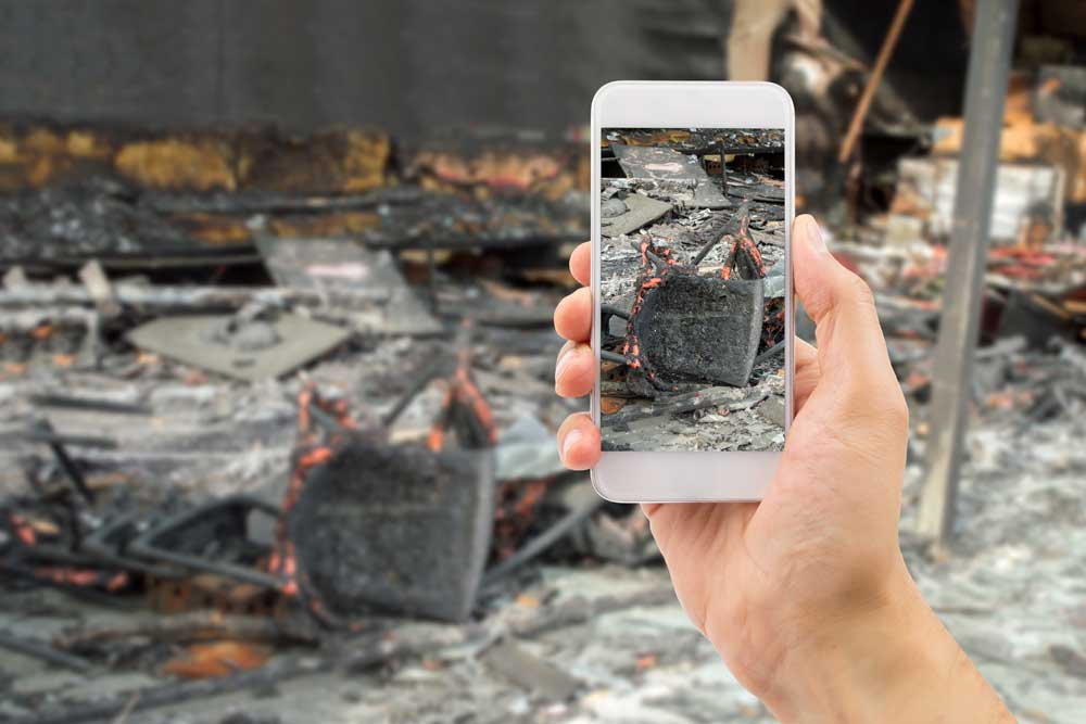 firefighter smartphone taking picture of scene