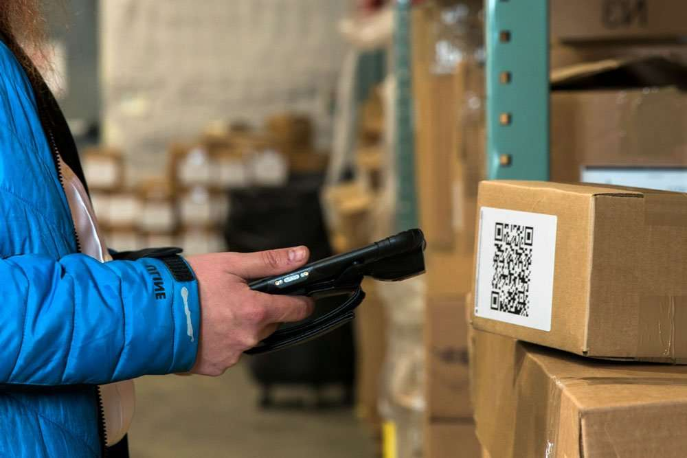 Sonim RS80 Scanning a Barcode in a Warehouse