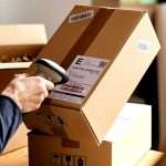 Scanning a Barcode on a Product Box with Shipping Information