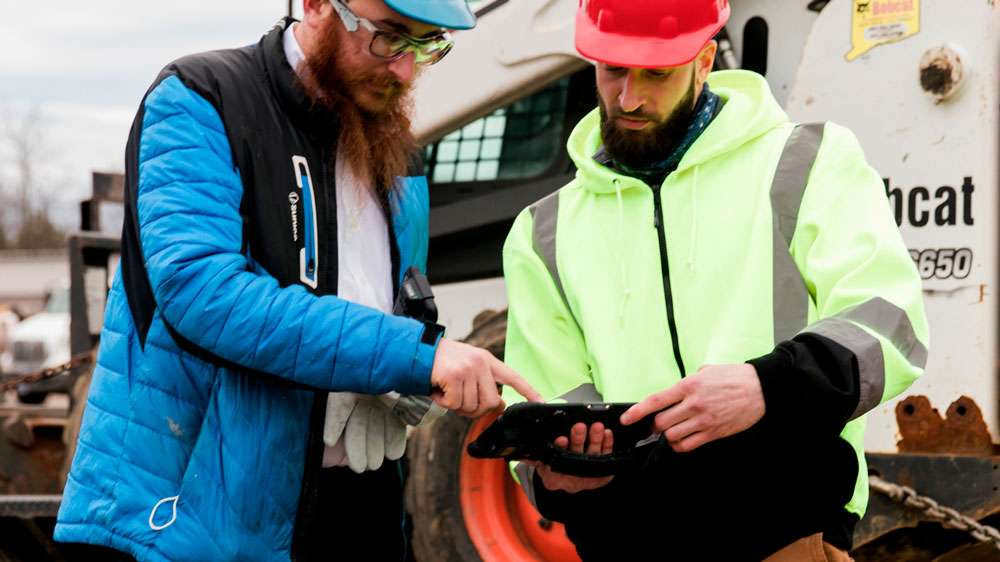 Sonim RS80 Rugged Tablet with Barcode Scanner at Construction Site with Tractor