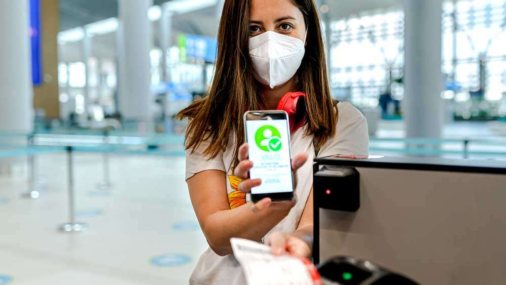 Woman travelling with Covid Vaccine App and Scanning with Device