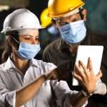 Construction Workers with Industrial Tablet Working