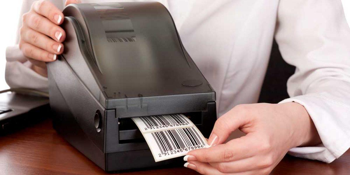 Woman printing UPC Codes from printer